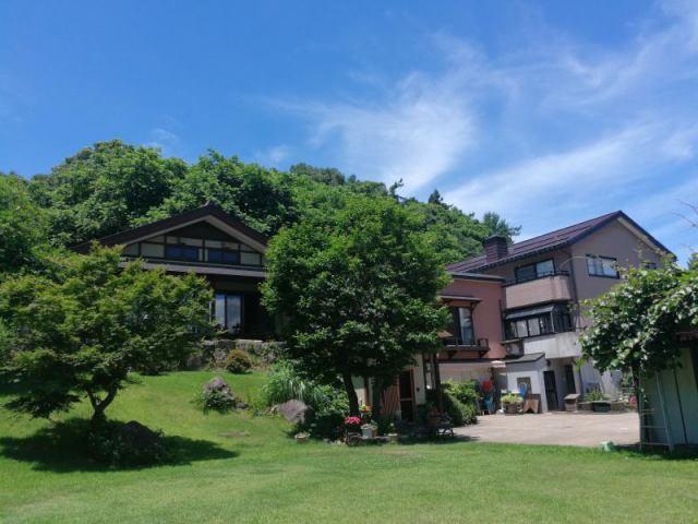 飯山市飯駒 広大な耕地付住宅の外観写真