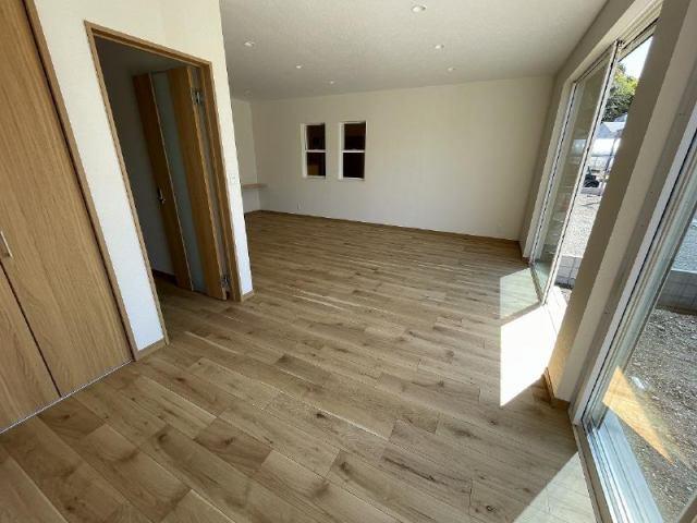 有限会社グローバル住宅 内観写真 広いリビングルームで快適です。